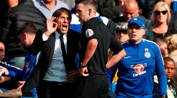 Chelsea manager Antonio Conte remonstrates with referee Michael Oliver after David Luiz was shown a red card