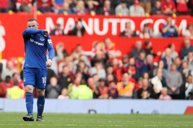 A dejected Wayne Rooney of Everton during the Premier League match between Manchester United and Everton at Old Trafford on September 17, 2017 in Manchester, England. (Photo by Matthew Ashton - AMA/Getty Images)