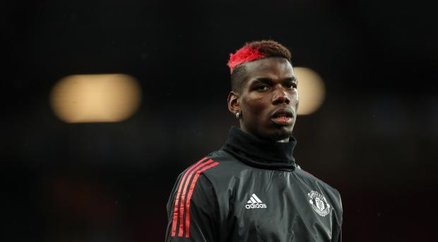 Paul Pogba of Manchester United warms up during the UEFA Champions League match between Manchester United and FC Basel at Old Trafford on September 12, 2017 in Manchester, England. (Photo by Robbie Jay Barratt - AMA/Getty Images)