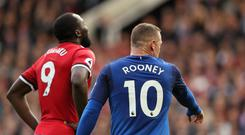 Romelu Lukaku of Manchester United is marked by Wayne Rooney of Everton as a corner is taken during the Premier League match between Manchester United and Everton at Old Trafford on September 17, 2017 in Manchester, England. (Photo by Matthew Ashton - AMA/Getty Images)
