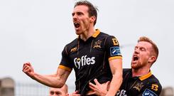Chris Shields (left) and Sean Hoare join in as David McMillan celebrates after after scoring Dundalk's first goal against Shamrock Rovers in the EA Sports Cup final at Tallaght. Photo by Stephen McCarthy/Sportsfile