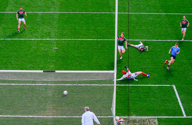 Con O'Callaghan of Dublin shoots to score his side's first goal past Mayo goalkeeper David Clarke during the GAA Football All-Ireland Senior Championship Final match between Dublin and Mayo at Croke Park in Dublin. Photo: Sportsfile