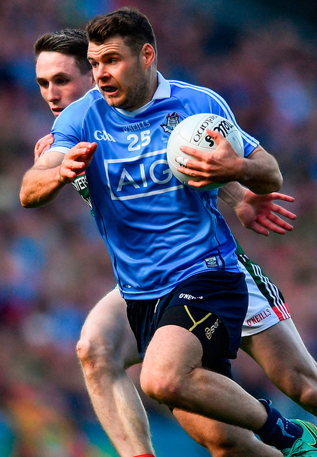 Kevin McManamon of Dublin is tackled by Paddy Durcan of Mayo. Photo: Sportsfile