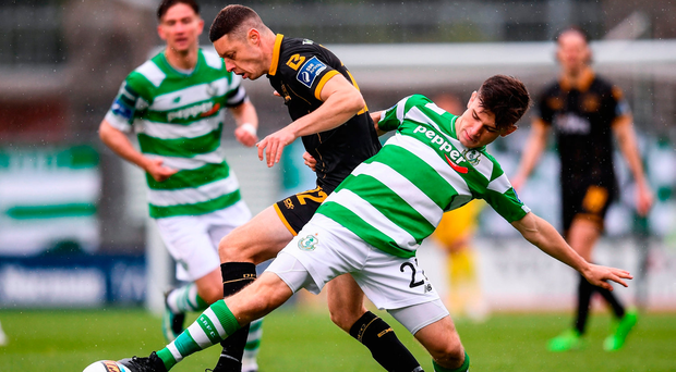 Shane Grimes of Dundalk in action against Aaron Bolger of Shamrock Rovers. Photo by Stephen McCarthy/Sportsfile