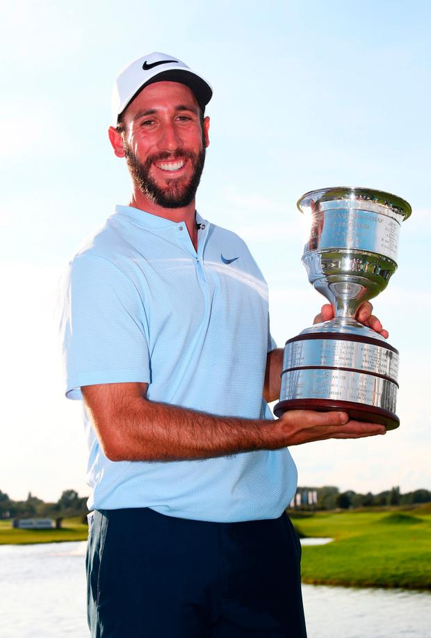 Romain Wattel celebrates with the trophy after winning the KLM Open at The Dutch. Photo by Dean Mouhtaropoulos/Getty Images