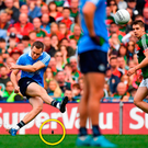 Dean Rock keeps his concentration to kick the winning point despite an object (circled) being thrown in his direction. Photo: Sportsfile