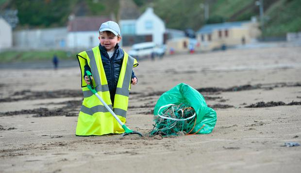 16-month-old Darragh O'Sullivan, from Macroom, Co Cork, arrived to help clean up. Photo: Domnick Walsh