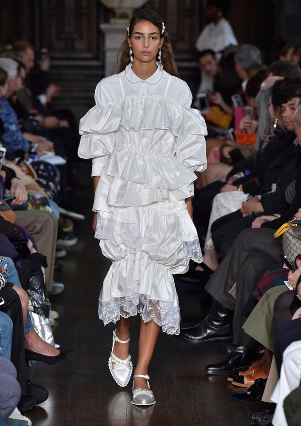Rich handwork and playful innocence in two looks by Simone Rocha at her LFW show at Middle Temple, the British law chamber