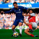 Chelsea's Eden Hazard is tackled by Arsenal's Mohamed Elneny during the Premier League match at Stamford Bridge. Photo by Mike Hewitt/Getty Images