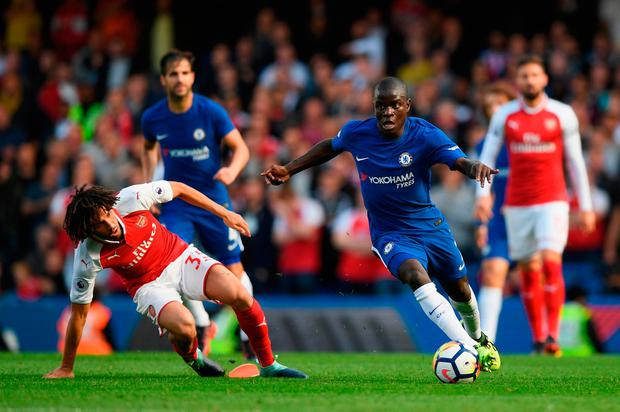 Mohamed Elneny of Arsenal and N'Golo Kante of Chelsea battle for possession. Photo by Shaun Botterill/Getty Images