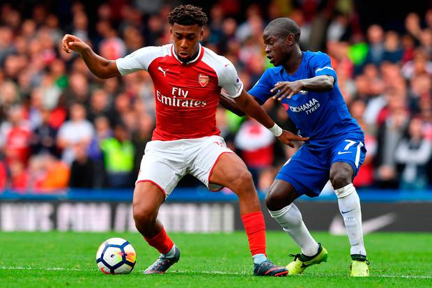 Arsenal's Nigerian striker Alex Iwobi (L) vies with Chelsea's French midfielder N'Golo Kante. Photo; Getty Images