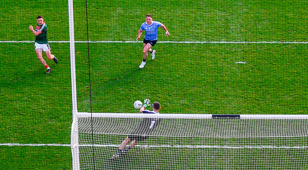 Stephen Cluxton saves a shot from Mayo's Jason Doherty in the second half. Photo: Sportsfile
