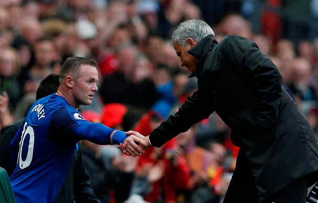 Jose Mourinho shakes hands with Wayne Rooney after his substitution. Photo: Reuters/Andrew Yates
