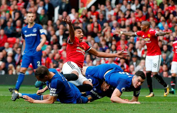 Manchester United's Jesse Lingard in action with Everton's Ashley Williams, Phil Jagielka and Michael Keane. Photo: Reuters/Andrew Yates