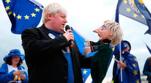 A Boris Johnson impersonator holds a Theresa May puppet during an Exit for Brexit rally yesterday at the Liberal Democrats Autumn Conference in Bournemouth, England. Photo: Andrew Matthews/PA.