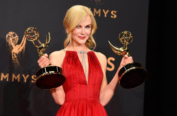 Nicole Kidman poses with her awards for outstanding lead actress in a limited series or a movie and outstanding limited series for