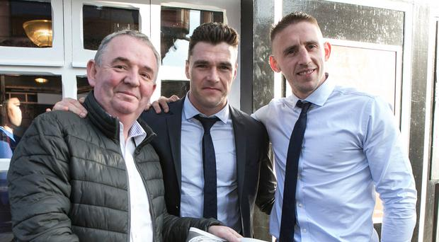 Hugh Hourican owner of The Boars Head on Capel St with All Ireland Winners Paddy Andrews and Eoghan O'Gara .
