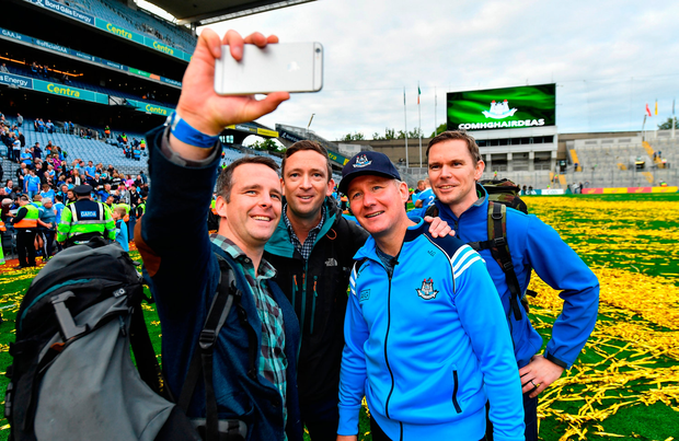Dublin manager Jim Gavin has a selfie taken with members of the Air Corps who flew over Croke Park before the game, including Capt Sean McCarthy, Cmdt Frank Byrne and Capt Enda Walsh