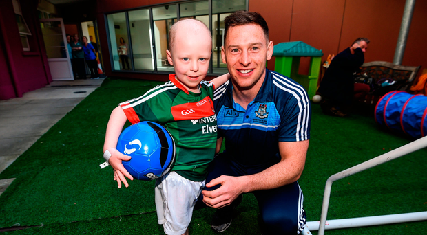 18 September 2017; Dublin footballer Philip McMahon with Mayo supporter Cathal Downey, aged 4, from Co. Kildare during the All-Ireland Senior Football Champions visit to Our Lady's Children's Hospital in Crumlin, Dublin. Photo by David Fitzgerald/Sportsfile