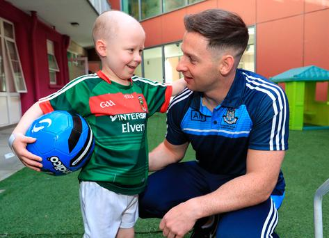 Mayo fan, Cathal Downey, from Kildare with Dublin's Philly McMahon pictured this morning at Our Lady's Hospital for Sick Children, Crumlin during a visit of the All Ireland winning Dublin team.