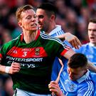 Donal Vaughan of Mayo tackles John Small of Dublin