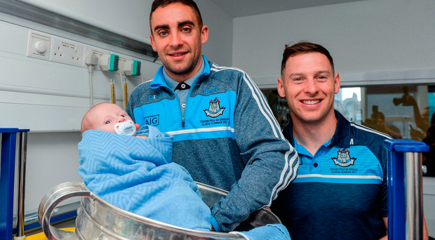 James McCarthy, left, and Philly McMahon with Conal Barker-Keogh, 16 days old, from Mulhuddart in Dublin, during the All-Ireland Champions' visit to Temple Street Children's Hospital in Dublin. Photo: Sportsfile