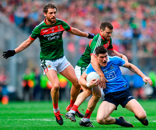 Dublin's Diarmuid Connolly of is fouled by Mayo's Chris Barrett to earn the winning free for the All-Ireland champs. Photo: Sportsfile
