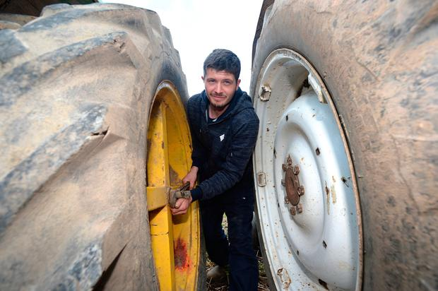 Michael J Donegan, from Causeway, Co Kerry, gets ready for the Ploughing Championships in Screggan. Photo: Justin Farrelly