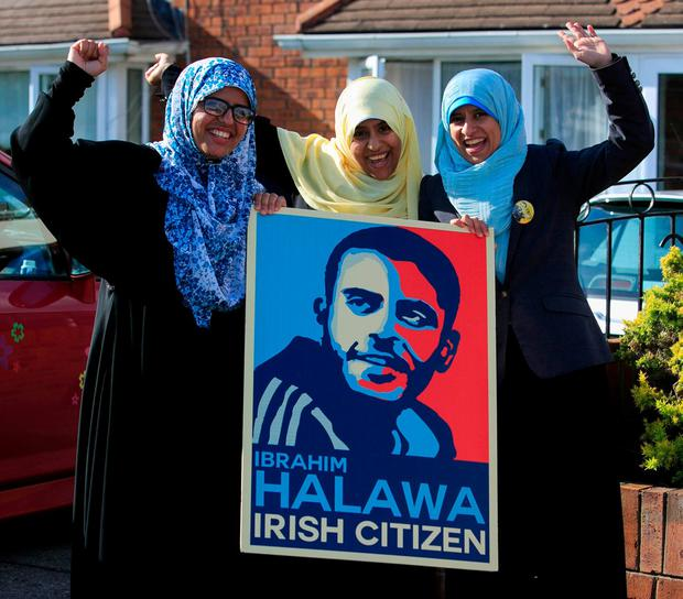 Sisters of Ibrahim Halawa, from left, Fatima, Omaima and Somaia, celebrate the news their brother had been acquitted, at the family home in Firhouse, Dublin. Photo: Gareth Chaney
