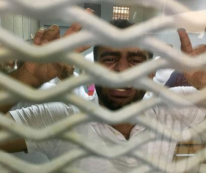 Ibrahim Halawa celebrates moments after his acquittal of various charges at the Wadi el-Natrun prison outside Cairo yesterday. Photo: Declan Walsh/The New York Times/Redux