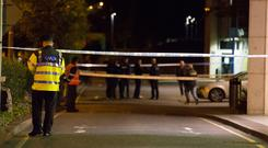 Gardai investigate the shooting of a man in his twenties at a shopping centre car park near Citywest