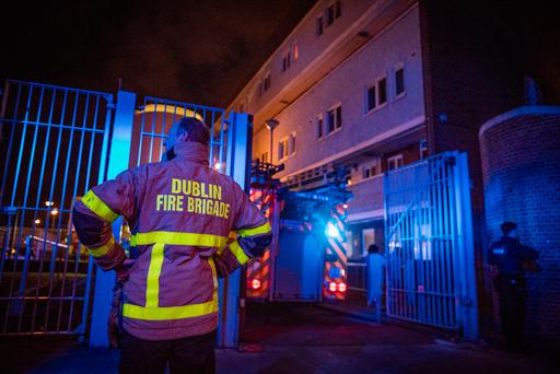 DFB tend to a fire at Tyronne Place, where a woman and three children were injured. Picture: Arthur Carron