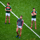 17 September 2017; Dejected Mayo players, left to right, Kevin McLoughlin, Danny Kirby, Aidan O'Shea, David Drake, and physio Martin McIntyre, watch the Sam Maguire presentation after the GAA Football All-Ireland Senior Championship Final match between Dublin and Mayo at Croke Park in Dublin. Photo by Daire Brennan/Sportsfile