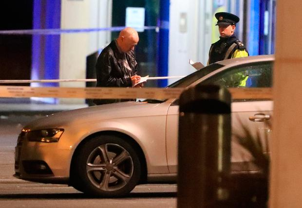Gardai at the scene on Fortunstown Lane near the City West Shopping centre where a man was shot dead in a vehicle tonight..Picture Colin Keegan, Collins Dublin.
