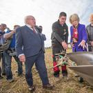 Sean Tracey fom Carlow shows President Michael Daniel Higgins and his wife Sabina his plough at the opening day of the National Ploughing Championships in Screggan, Tullamore, Co Offaly. Also included is Anna May McHugh Pic:Mark Condren