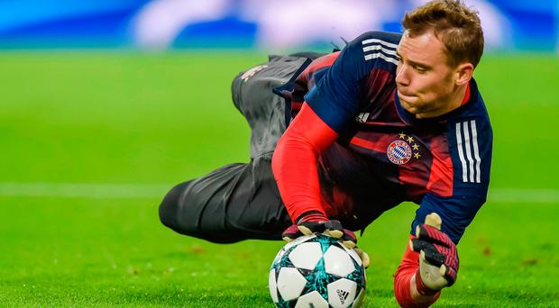 (FILES) This file photo taken on September 12, 2017 shows Bayern Munich's German keeper Manuel Neuer warming up ahead the Champions League group B match between Bayern Munich and RSC Anderlecht in Munich, southern Germany. AFP PHOTO / GUENTER SCHIFFMANNGUENTER SCHIFFMANN/AFP/Getty Images