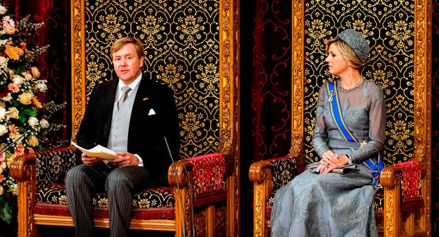 Dutch King Willem-Alexander delivers his 'Speech from the Throne' next to Queen Maxima in the Ridderzaal (Knights' Hall), during 'Prinsjesdag' (Prince's Day) in The Hague on September 19, 2017