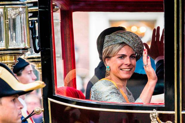 Dutch Princess Laurentien waves from a Carriage during the 'Prinsjesdag' (Prince's Day) at the Binnenhof in The Hague on September 19, 2017