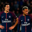 Paris Saint-Germain's Uruguayan forward Edinson Cavani (L) and Paris Saint-Germain's Brazilian forward Neymar