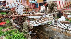 Undated handout photo issued by the MoD of members of the Armed Forces clearing debris from a storm drain before Hurricane Maria arrives, on the Island of Tortola. PRESS ASSOCIATION