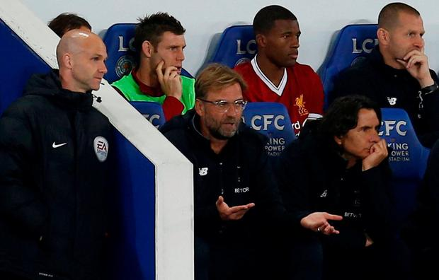 Liverpool manager Jurgen Klopp speaks to the fourth official Anthony Taylor during tonight's defeat