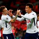 Tottenham's Dele Alli celebrates scoring their first goal with Kieran Trippier
