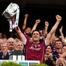 Galway's All-Ireland winning captain David Burke lifts the Liam MacCarthy Cup. Photo: Brendan Moran/Sportsfile