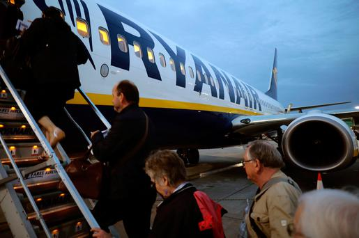 Passengers board a Ryanair flight at Stansted Airport, north-east of London, earlier this month. Photo: Reuters