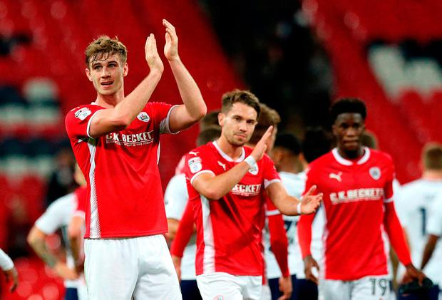 Barnsley's Liam Lindsay (left) acknowledges the fans after the final whistle Photo: Jonathan Brady/PA Wire