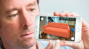 Adrian Weckler demonstrates the mixed-reality function of the new iPhone 8 Photo: Tony Gavin