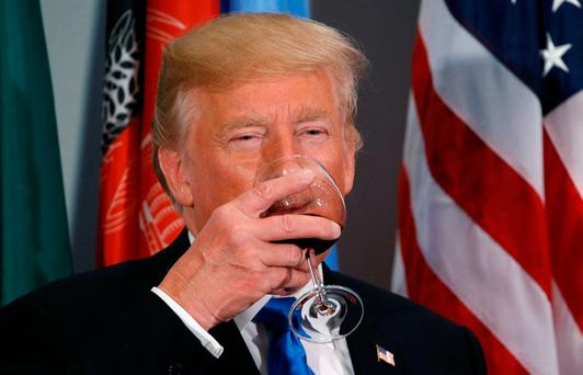 U.S. President Donald Trump toasts during a luncheon hosted by the Secretary General of the United Nations in New York. Photo: REUTERS/Kevin Lamarque