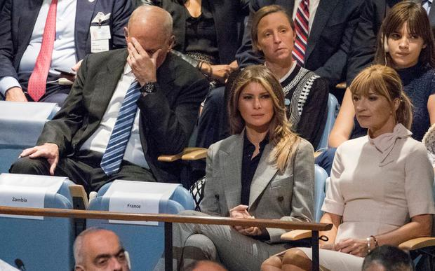 White House Chief of Staff John Kelly, left, reacts as he and first lady Melania Trump listen to U.S. President Donald Trump speak during the 72nd session of the United Nations General Assembly Credit: AP