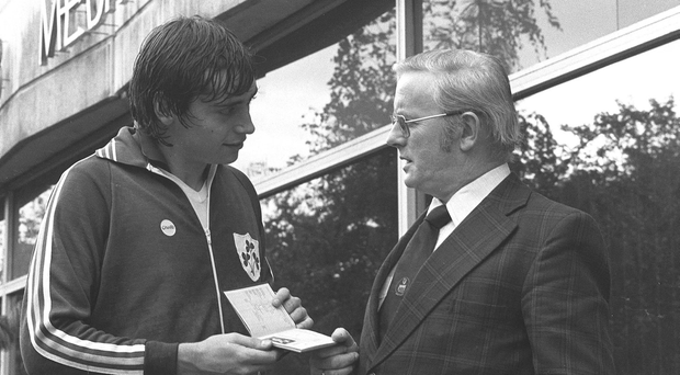 Michael Robinson, with his Irish passport, in conversation with the journalist and broadcaster Jimmy Magee