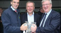 IFA President Joe Healy, the Minister for Agriculture Michael Creed and Supermac's MD Pat McDonagh with the Liam McCarthy Cup at the National Ploughing Championships in Screggan.